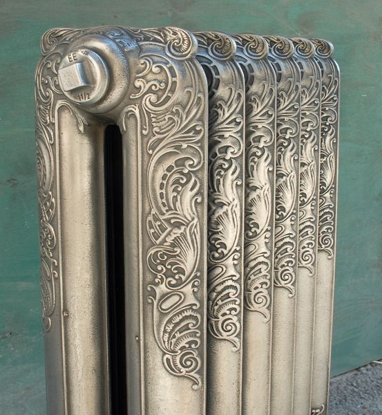 An original ornate cast iron radiator,
