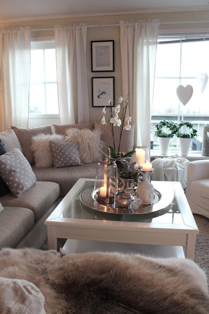 Modern Grey Living Room With Cozy Fur Pillows And Throws, Pretty Candles  And Flowers On The Coffee Table Tray Part 50
