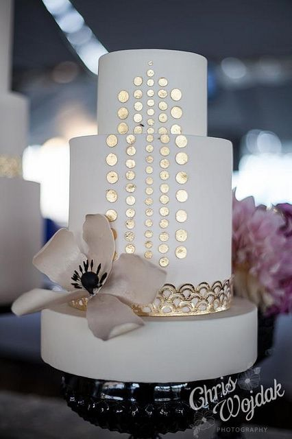 White wedding cake with gold.
