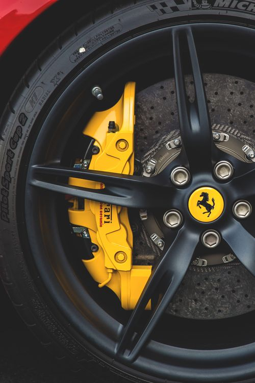 Ferrari caliper and rotor--huge stopping power! #CaliperCovers #MGP #Brembo