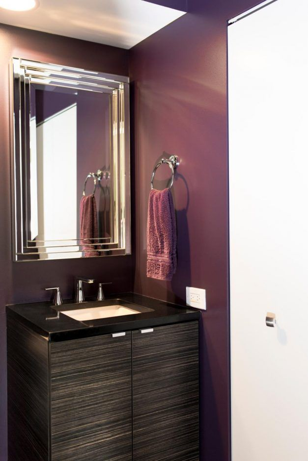 Bathroom: Plum Perfect. bathroom color. dark bathroom. purple bathroom.  metal mirror