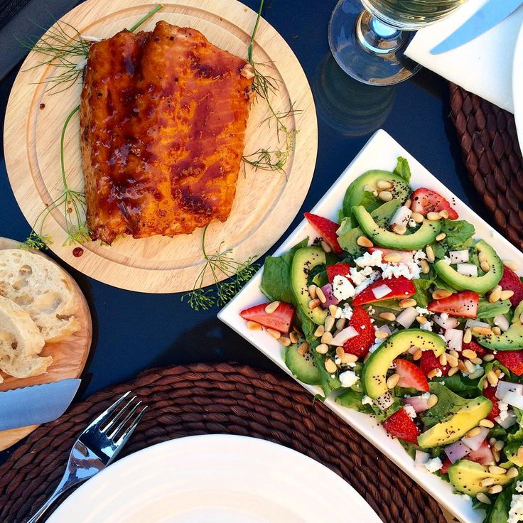 The warmer weather is back and we don't want to let it go! Cedar planked salmon alongside a strawberry, avocado and goat cheese salad with a poppy seed dressing. @zimmysnook