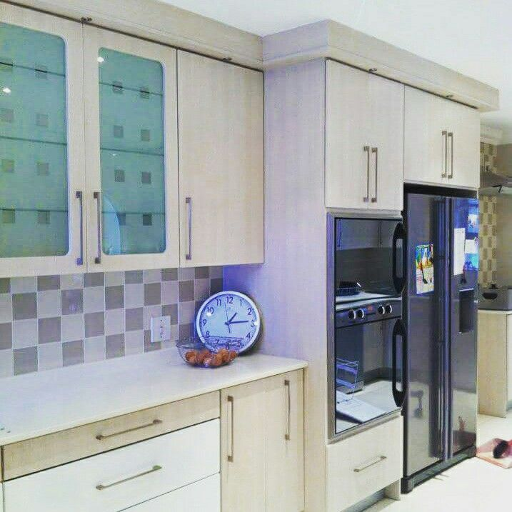 Two toned kitchen by Tuscany Kitchens and splice granite
