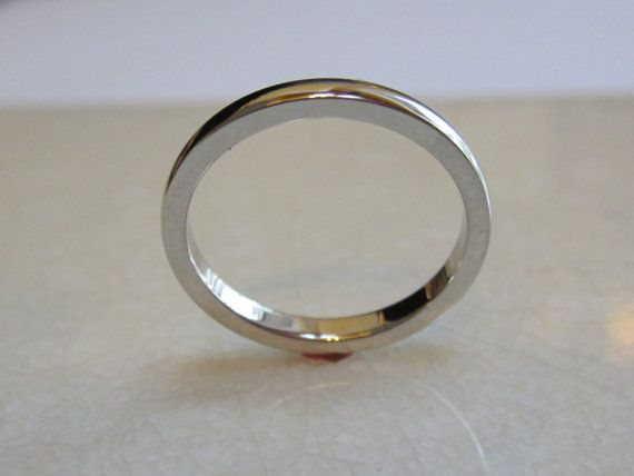 Skinny wedding band made from recycled palladium