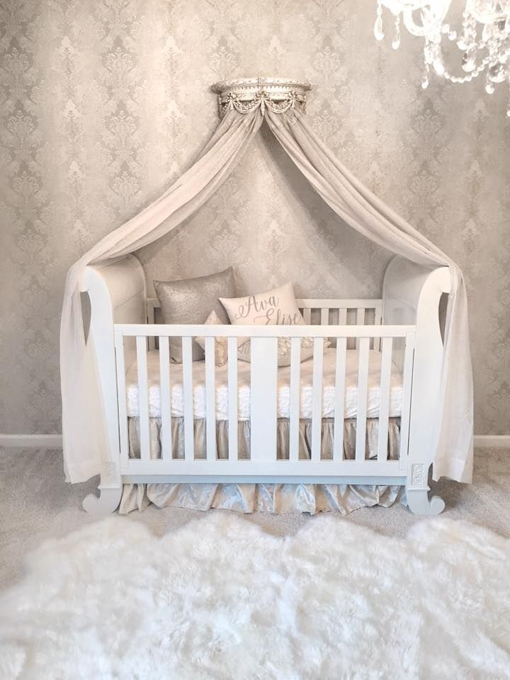 What's not to love?  This room is heavenly.  Get it all at brattdecor.com  chelsea sleigh crib white, urban sheepskin rug, chandelier, chelsea wall crown and bedding.