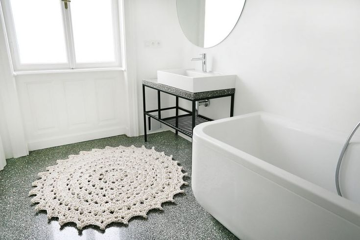 #Designcarpet Beautiful simple bathroom with a #Scandinavian style Mandala #crochet #handcrafted  design #rug. Perfect for this space and floor!