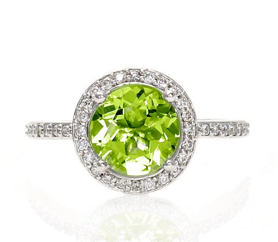 Hey, I found this really awesome Etsy listing at http://www.etsy.com/listing/130630194/14k-peridot-ring-diamond-halo-engagement