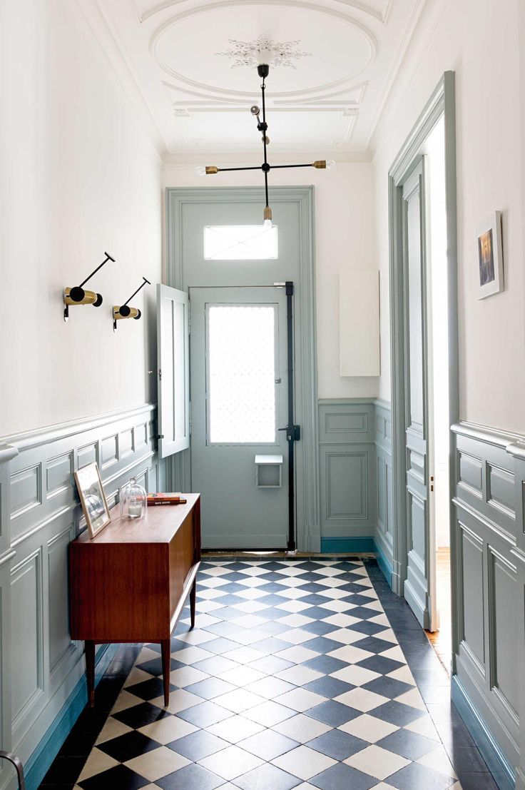 checkered tile and muted blue/gray molding