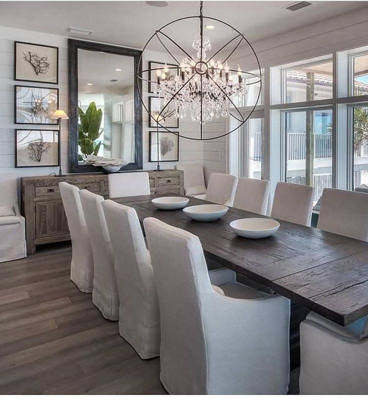 Modern Coastal Dining room with tongue and groove wall paneling,  slipcovered linen chairs and wide plank floors.