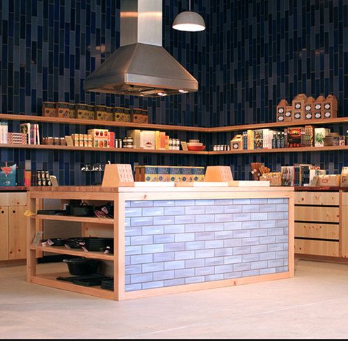 Neat idea for a kitchen island - tile to match or complement the backsplash