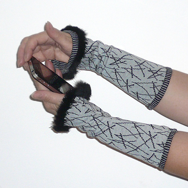 Light blue and black wrist warmers, cotton with small fur edge, arm cuffs, fingerless gloves, arm warmers. $36.00, via Etsy.