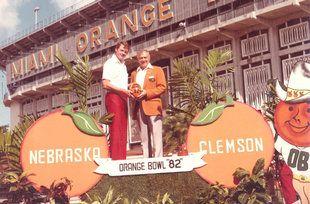 Nicholas Crane, right, at the old Orange Bowl with University of Nebraska coach Tom Osborne.