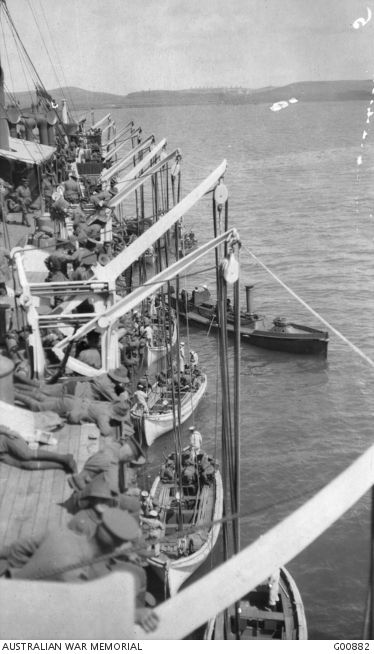 Troops of the 2nd and 3rd Australian Infantry Battalions, on the German prize Derfflinger. They are practising at climbing down rope ladders and landing in boats in Mudros Harbour, in preparation for the landing on Gallipoli Peninsula. The men on all transports carried out similar drill.