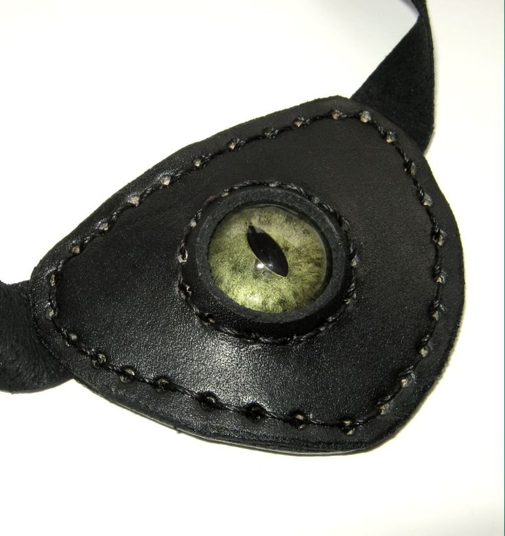 Leather Eye Patch Steampunk Black Eyepatch Green Glass Eye. $29.50, via Etsy.