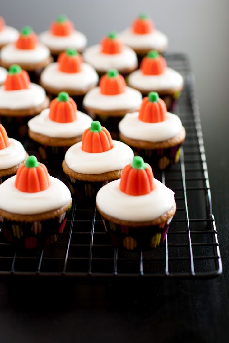 Mini pumpkin cupcakes, cream cheese frosting and candy pumpkins!