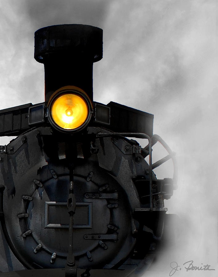 The Age of Steam by Joe Bonita. I love how the train emerges from the steam and the shine of the yellow light.