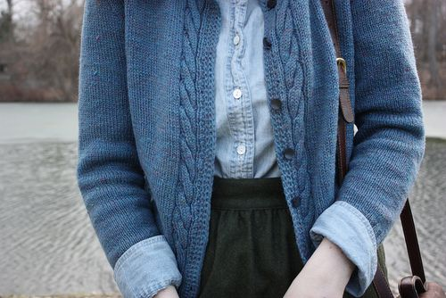 Cable knit sweater over button up shirt