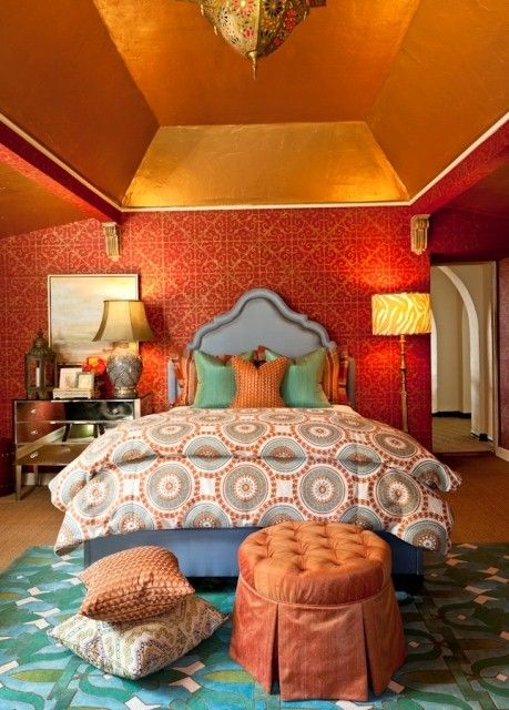 A middle eastern inspired bedroom. The orange and blues are amazing!