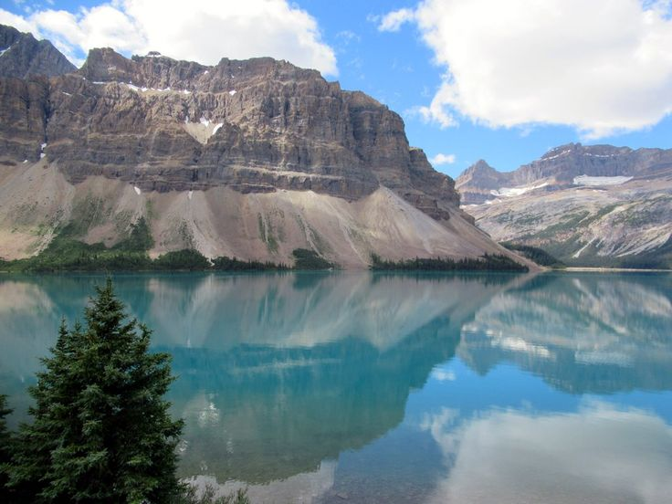 Glacial meltwater feeds the turquoise waters of Bow Lake on the Icefields Parkway in Alberta, Canada.