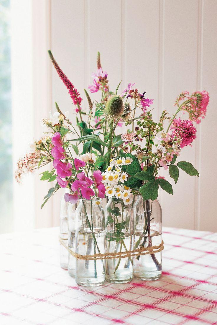 Make your own vase by bunching vintage milk bottles together.