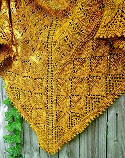 Ruxton is a super textured, warm and snuggly top-down triangular lace shawl with motifs inspired by nature. The decrease placement in the richly textured border pattern and the picot bind off combine to form a subtle ruffling effect at the bottom, giving the shawl a lovely drape. The shape is a slightly elongated triangle, and may be blocked with the top edge straight or a bit curved.
