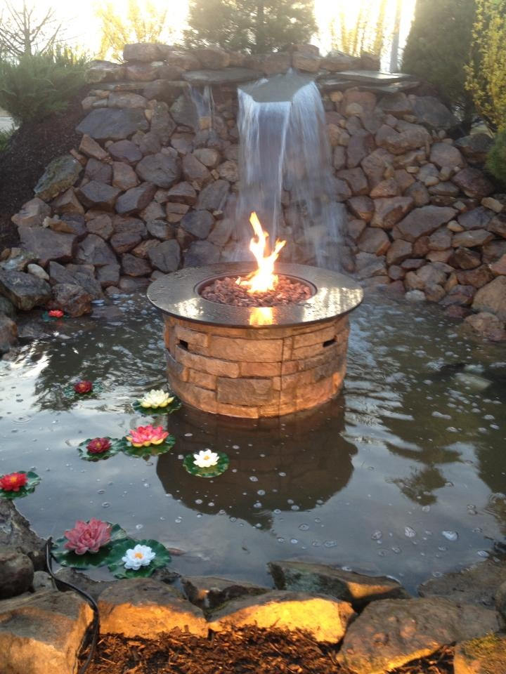 Allen roth fire table placed in a small water feature give for Fire and water features