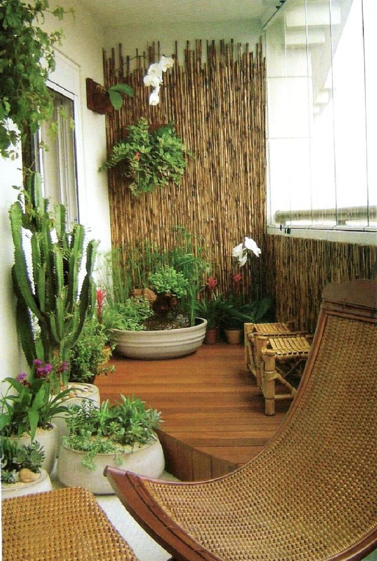 Mattresses why not hanging on the balcony garden compact seating - Transform Your Balcony Into A Mini Garden You Can Do This With Help From An Array Of Potted Plants Wooden Chairs And Bamboo Walls