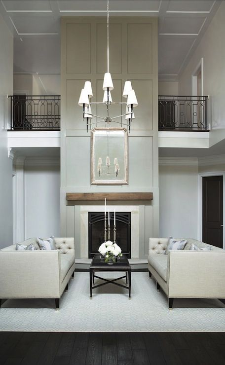 stunning two-story living room; board and batten fireplace