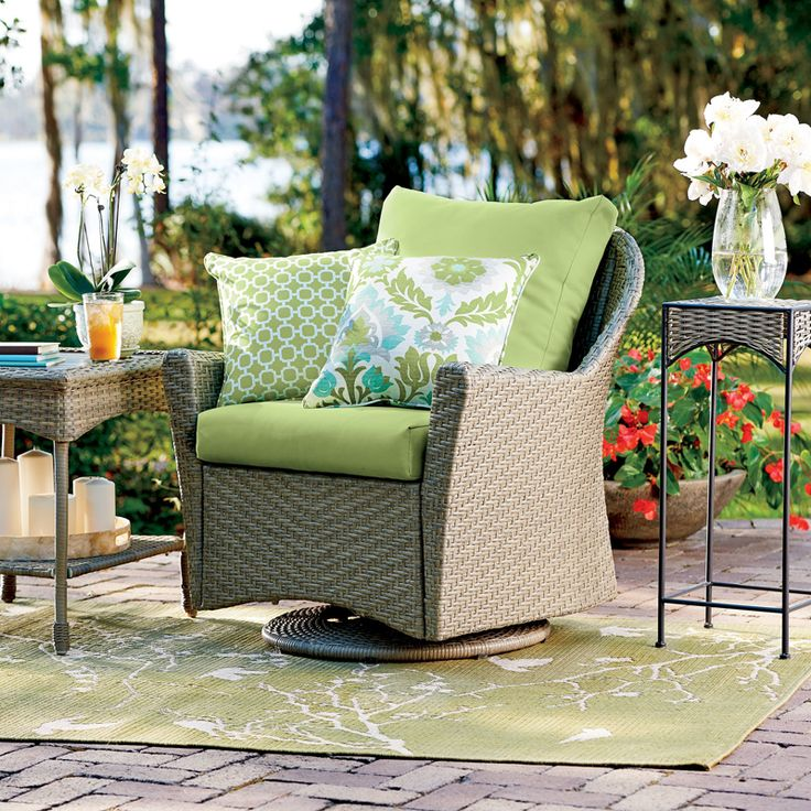Create The Perfect Space To Enjoy A Good Book With Our Portico Resin Wicker  Outdoor Swivel