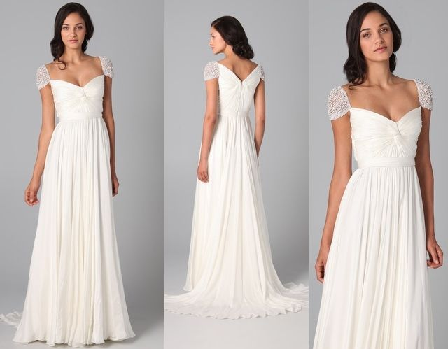 Gorgeous and simple wedding dress with cap sleeves.