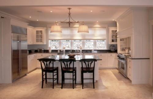 long u-shape kitchen, white cabinets, black granite, silver pulls, bar seating on island