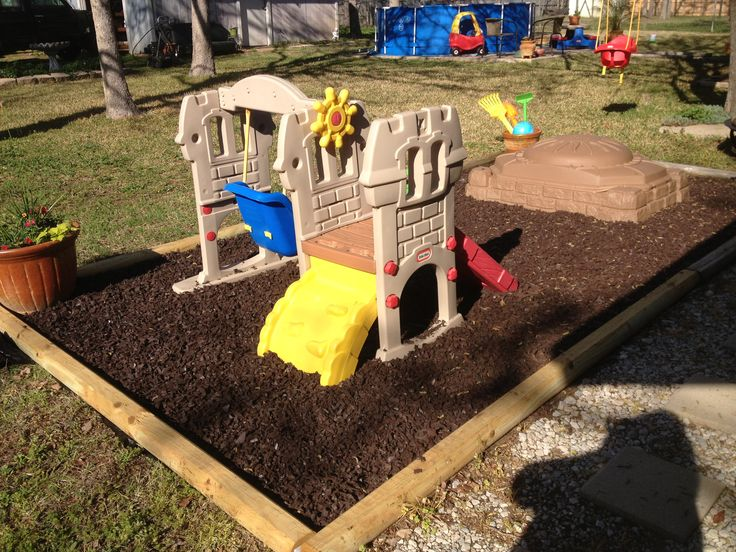 My sons playground area- squared off with landscape timber, put down some weed liner and filled with rubber mulch!