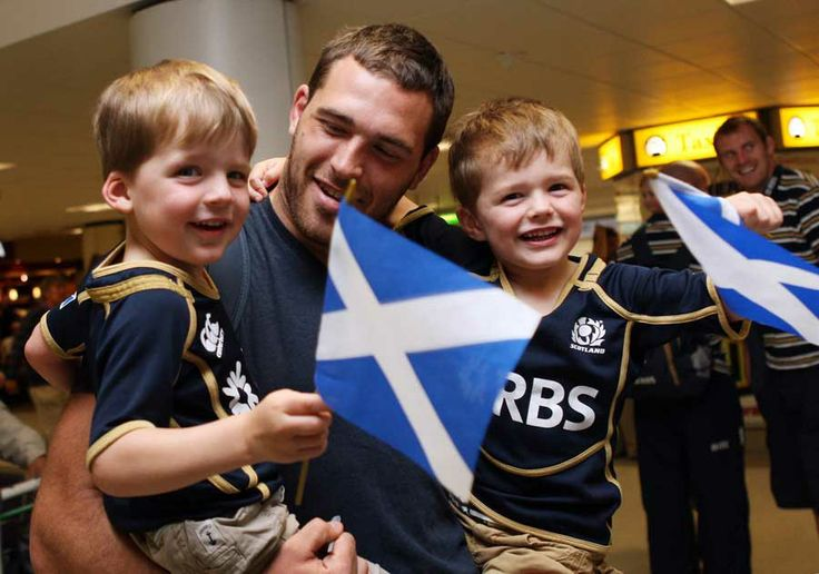 Scotland's Sean Lamont is greeted by his family