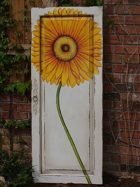 GuildMaster Decorative Door Panel  Painted with Yellow Floral Detail. {flickr, sophiesplace}  So, so pretty!!!! www.rehouseny.com has thousands of doors that need a pretty flower!