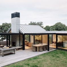 This beautifully designed beachfront property by Studio John Irving is the ultimate summer spot on Waiheke Island.