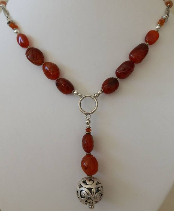 Today's treasure chest reveals this gorgeous carnelian necklace with its pretty feature pendant. At R200 including delivery, it's a steal. Carnelian is the life-enhancing stone that protects and bolsters confidence. It's the wearable fertility doll, treating infertility, menstrual problems and impotence. It is also effective in healing dermatological ailments such as acne and psoriasis, and even the skin disorders of pets.