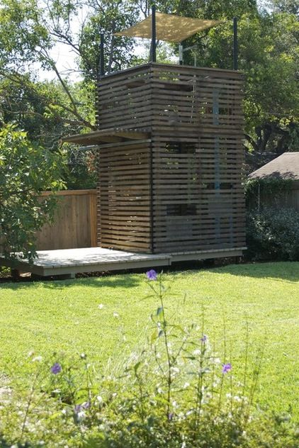 This is another of those easy-on-the-eyes structures. The tall, Jenga-like tower has peekaboo slats as well as its own deck and roof deck (complete with sail shade).