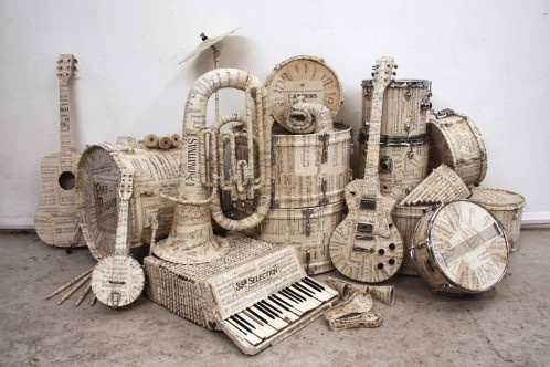 Hermes (UK) Christmas 2009 (Music manuscript covered instruments and map covered suitcases to complete window displays across the country. Creative Director: Rebecca Cocks) – Kyle Bean