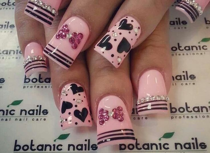 Pink Nails with stripes hearts and bling for Valentine's Day!