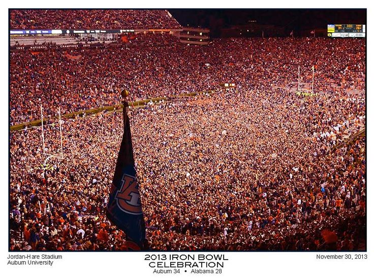 An absolute must have for Auburn fans. 2013 Iron Bowl Celebration Photo print. One of the greatest moments in college football history. We still have a few of these available at a great price.