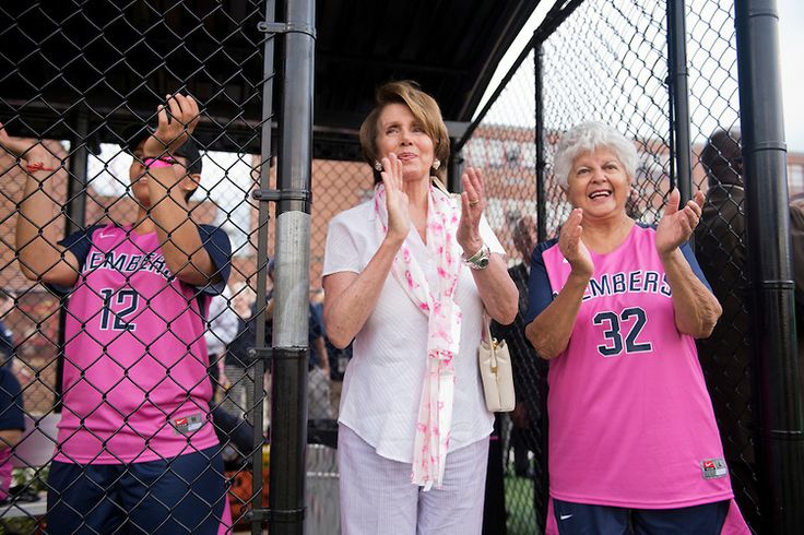 House Minority Leader Nancy Pelosi, D-Calif., center, and Rep. Grace Napolitano, D-Calif., attend the Congressional Women's Softball game. The game benefits the Young Survival Coalition that helps young women with breast cancer. (Photo By Tom Williams/CQ Roll Call)