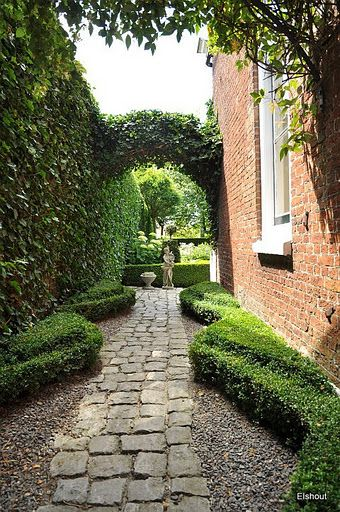 Nice curved boxwood side yard pathway