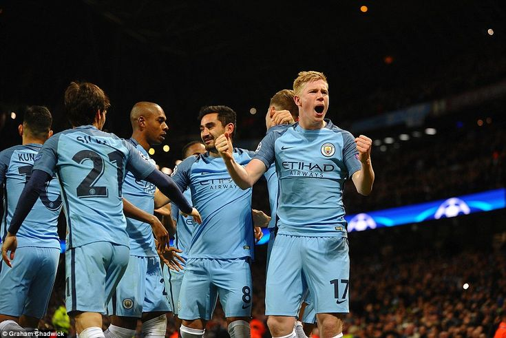 De Bruyne roars with delight after his superb shot flew past Barcelona's Marc-Andre ter St...