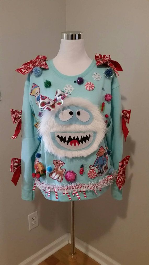 Girly Bumble Abominable Snowman with Isle of Misfit Toys, Yukon Cornelius, Dentist Elf, SO MUCH GOING ON! Size: Womens XL Hanes Super Soft inside Sweatshirt! Shown on Womens Medium mannequin) This novelty sweater is AWESOME!!! For All of my novelty sweaters everything is attached using quality Hot Glue. CARE of your Sweater: Your sweater cannot be washed. You may spot clean areas carefully. If your sweater includes lights, they are attached! I recommend wearing a T-Shirt, Turtle neck, or…