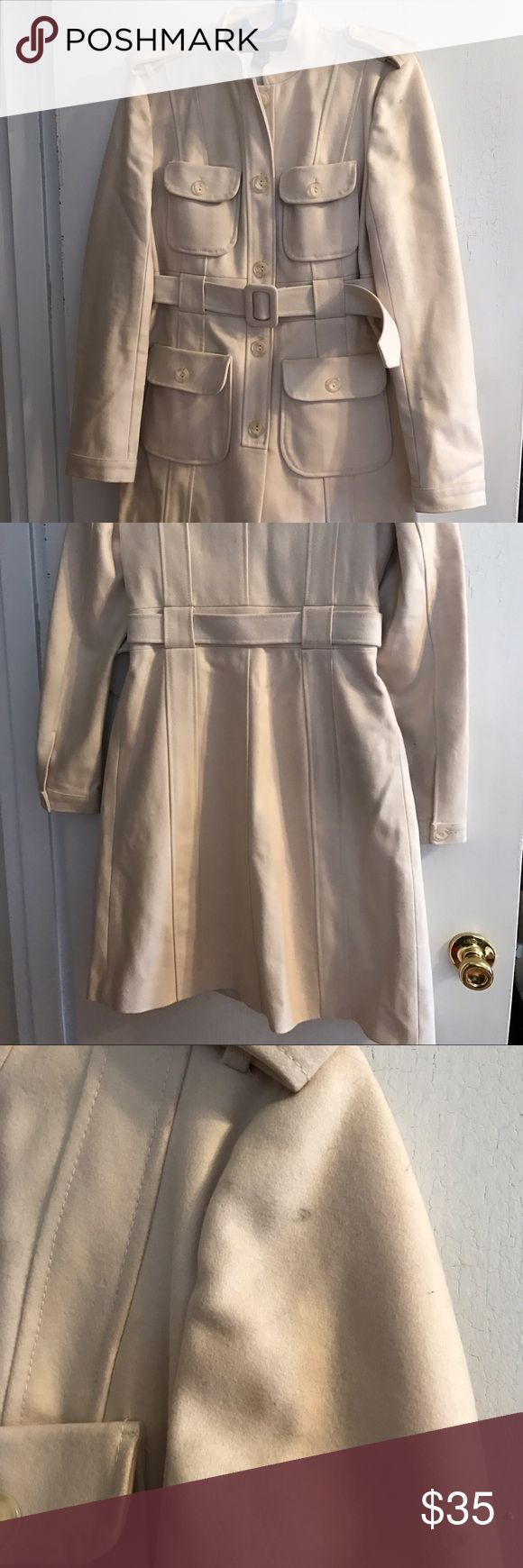 White cream  French Connection coat 6 Size 6. Some small stains, coat would use cleaning. Flaws pictured, some dents in the fabrics. Priced low due to the coat being in fair condition. French Connection Jackets & Coats Trench Coats
