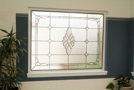 Keep wandering eyes at bay with privacy stained glass for your bathroom in your Houston home.