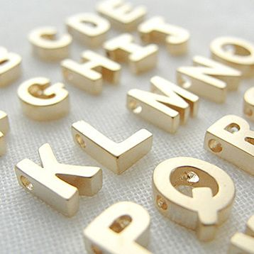 This small gold initial necklace is so tiny! Tiny letter rests on a 17 inch gold filled or sterling silver chain. A little letter necklace that is so easy to stack with other necklaces! So dainty but still very sturdy!Uppercase letter measures approximately 1/4 inch wide x 1/4 inch high.If you would like to give our jewelry as a gift, we also offer gift wrapping for $3.99 per box.  Please be sure to read the shop policies before making your purchase. Materials: Gold plated over brass. Chain…