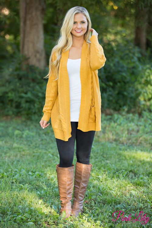 You have to grab this classic cardigan for your wardrobe - it's simply the best for fall! We adore the wonderfully soft knit fabric paired with a vibrant shade of mustard yellow - you can't go wrong with this one!