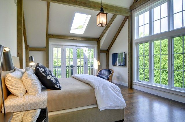 The barn homes post and beam master bedroom. Love the wall of windows! #floorplans