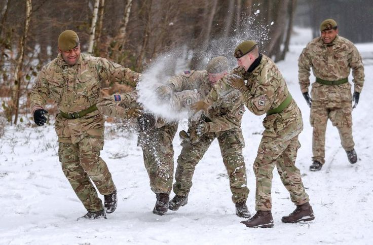 Members of 1st Battalion Welsh Guards take part in a snow ball fight before the combined St David's Day celebration and pre-deployment service at Elizabeth Barracks, Pirbright, Surrey. PRESS ASSOCIATION Photo. Picture date: Thursday March 1, 2018. Photo credit should read: Andrew Matthews/PA Wire